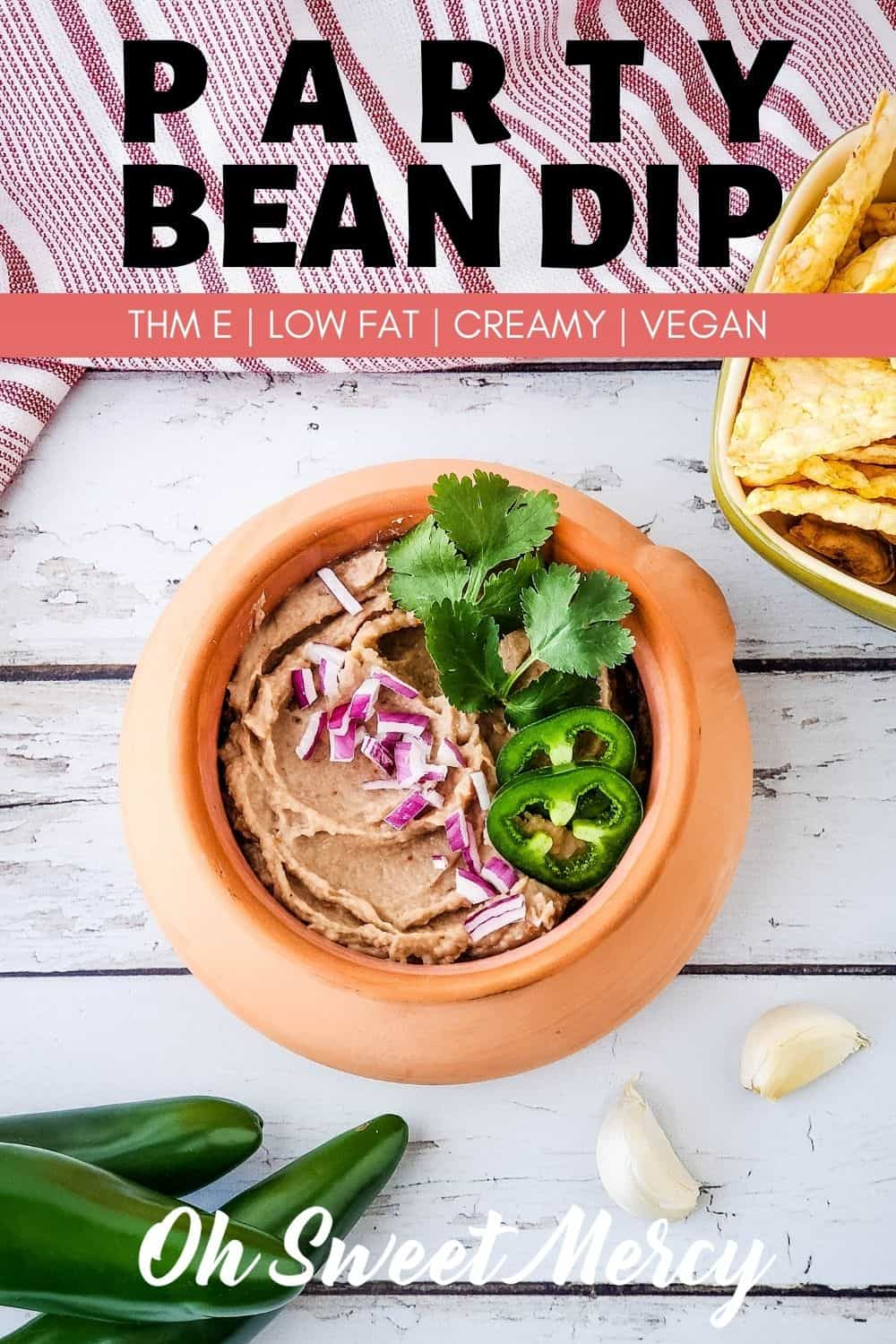 Low fat party bean dip that everyone will love? I've got that for you! This bean dip is creamy and flavorful - you'll never miss the fat! Great for THM snacks and serving at parties and get togethers. #thm #beandip #lowfat #vegan #partyfood @ohsweetmercy