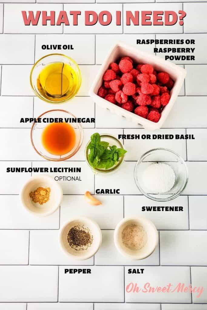 Raspberry Basil Vinaigrette Dressing ingredients: olive oil, apple cider vinegar, raspberries or raspberry powder, fresh or dried basil, garlic, sweetener, salt, pepper, optional sunflower lecithin