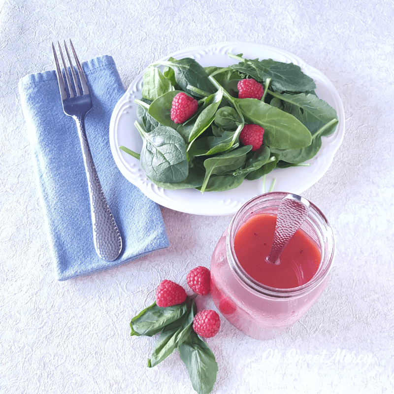 this easy 5 Minute Raspberry Basil Vinaigrette Dressing is #lowcarb #sugarfree and perfect for #thm S meals, keto dieters, and diabetics. No blender needed, either! #homemadevinaigrette