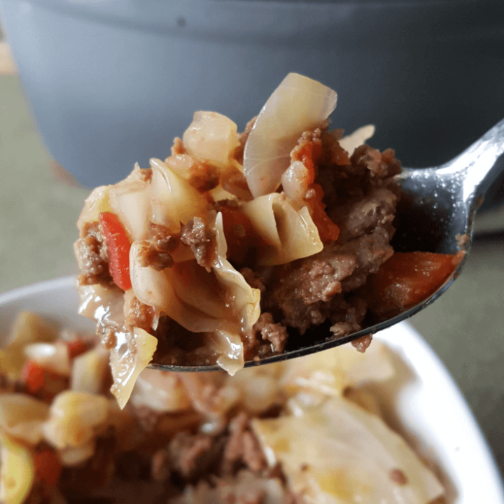 My Easy Cabbage and Sausage Stew is a tasty, filling, slimming recipe that only needs 4 ingredients! Delicious any time of year, too. #thm #lowcarb #easy #cabbage #recipes