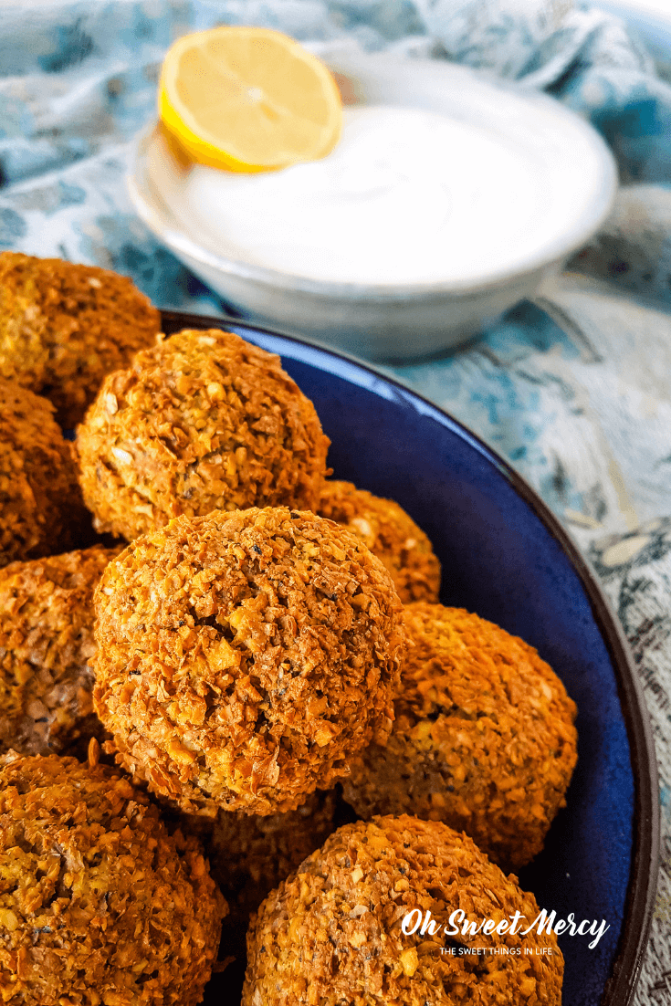 Crispy outside, moist and flavorful inside without deep frying? Yes! My Air Fryer Falafel with Creamy Tahini sauce is made without deep frying but you'll never miss the oil. THM E friendly, low fat, and so delicious! #thm #lowfat #airfryer #falafel