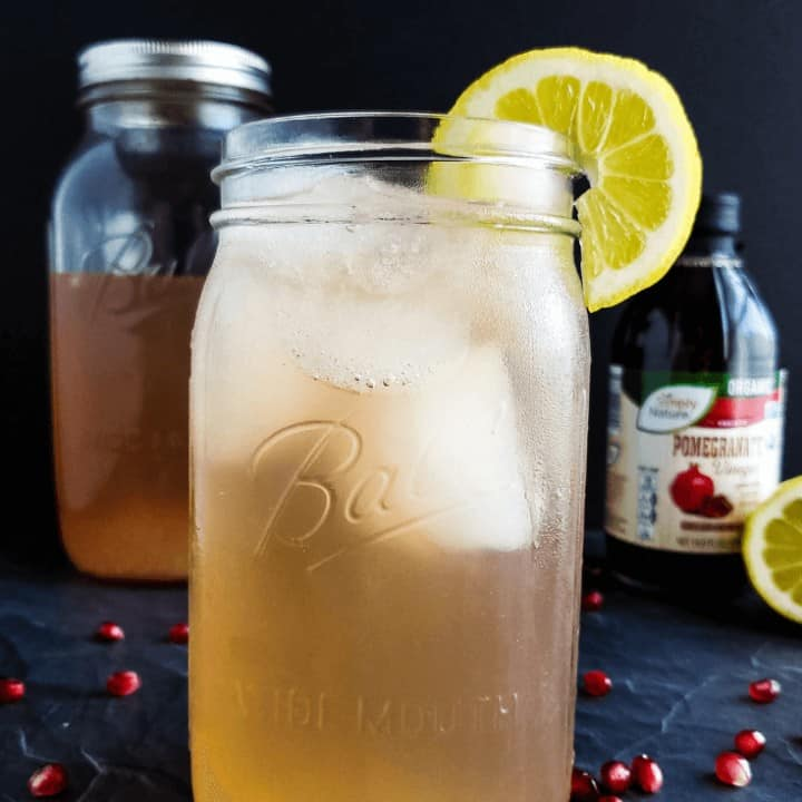 A delightful alternative to apple cider vinegar, raw pomegranate vinegar makes this Pomegranate Lemonade Good Girl Moonshine a healthy THM sipper. #sugarfree #thm #sipper