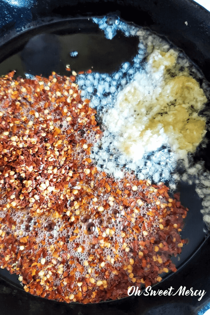 Cooking red pepper flakes and garlic in a skillet