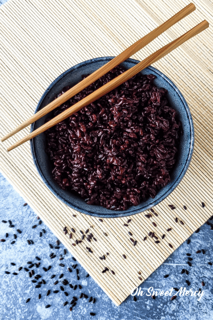 bowl of black rice with chopsticks