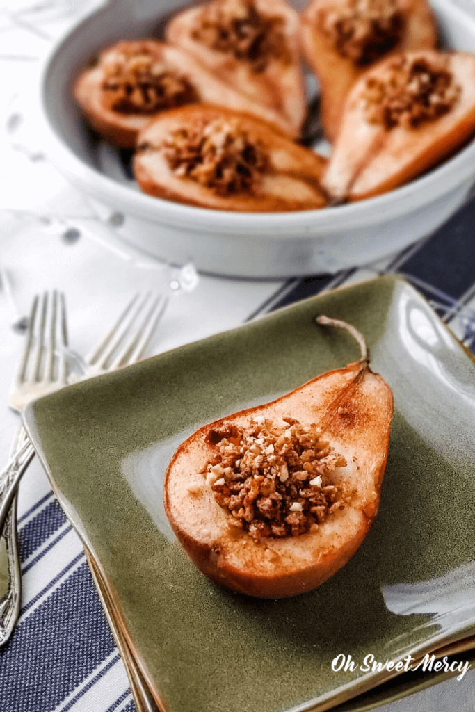 Baked pear half on a plate