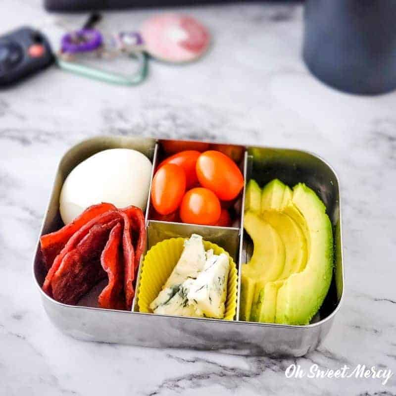 Cobb style snack box - hard cooked egg, cooked turkey bacon, cherry tomatoes, avocado slices, blue cheese.