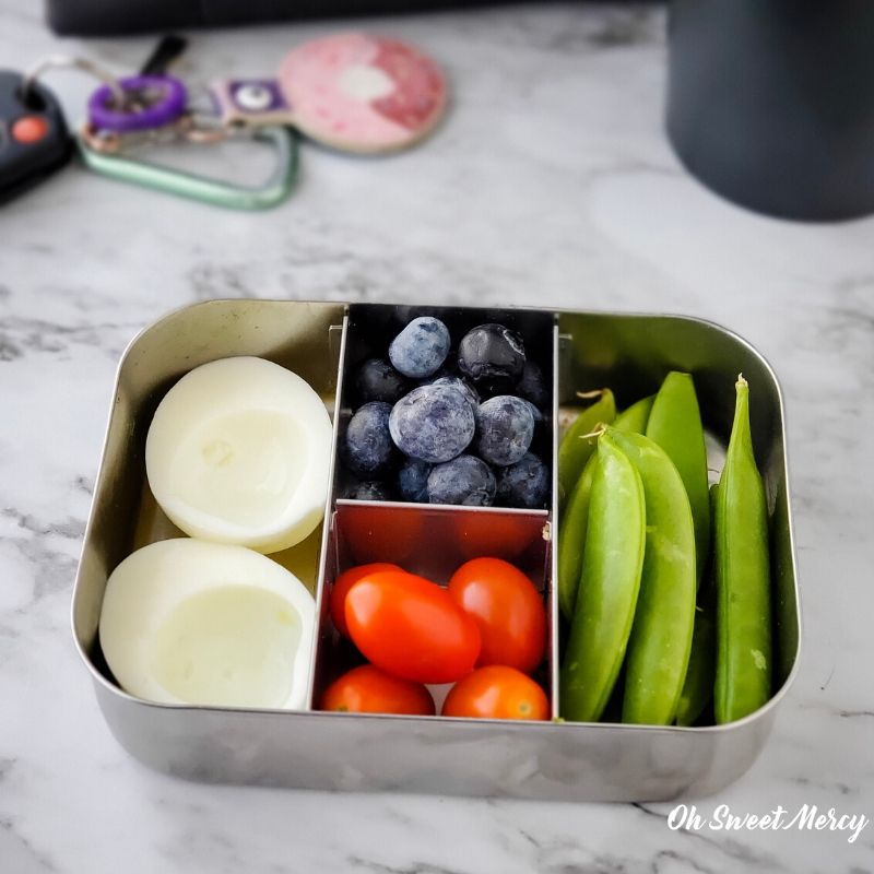 Light and lovely snack box - hard cooked egg white, cherry tomatoes, sugar snap peas, fresh berries.