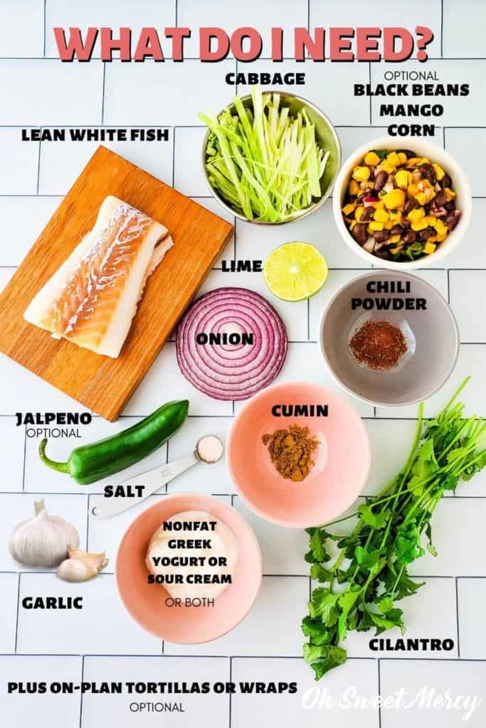 Fish tacos ingredients: skinless, lean, white fish, shredded cabbage, onion, lime, garlic, salt, cumin, chili powder, nonfat Greek yogurt or sour cream, jalapeno, black beans, corn, mango, cilantro, tortillas.
