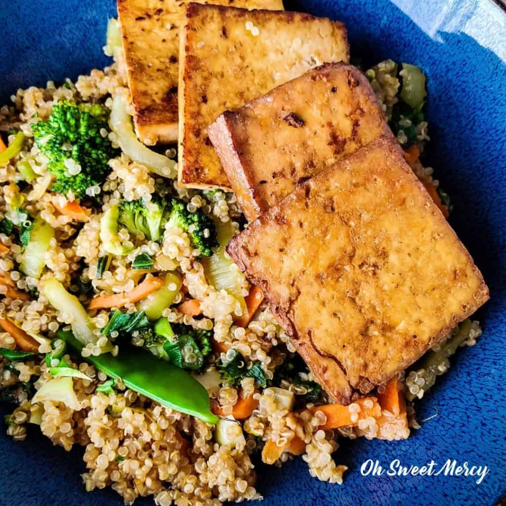 Close up of garlic ginger lime marinated tofu and quinoa