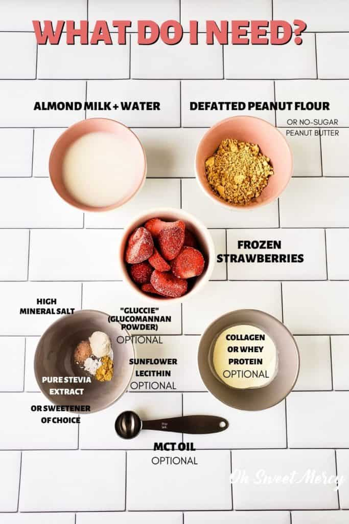 Peanut butter and jelly smoothie ingredients: almond milk and water, pressed peanut flour or peanut butter, frozen strawberries, sweetener of choice, sunflower lecithin, pink salt, glucomannan powder, whey or collagen, mct oil