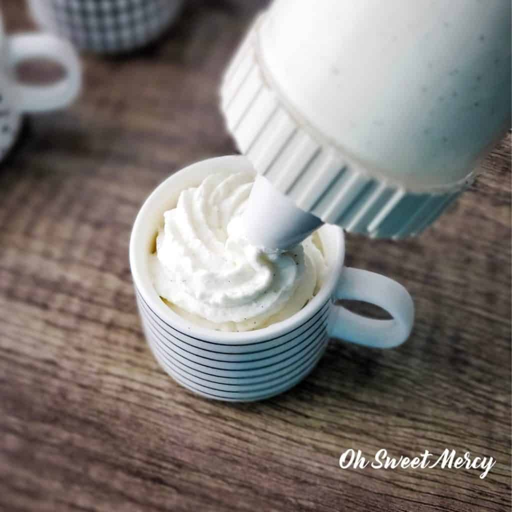 Piping vanilla bean mousse into cup