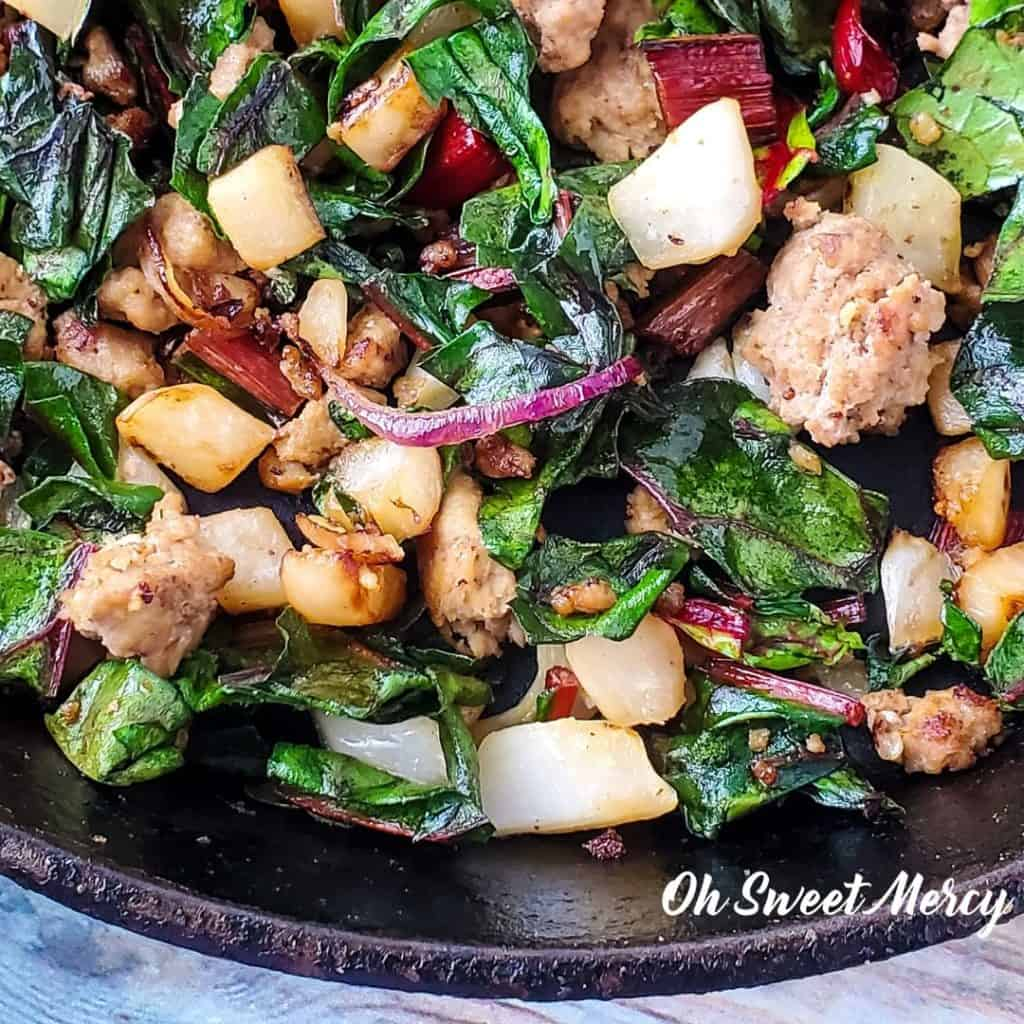 Turkey, fennel, and swiss chard in skillet