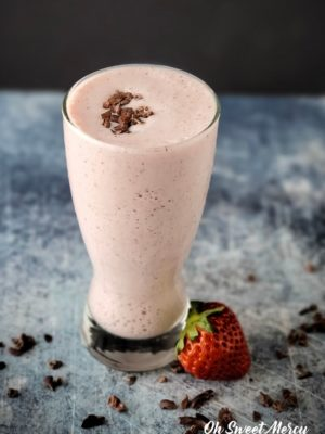 Glass of chocolate covered strawberry smoothie