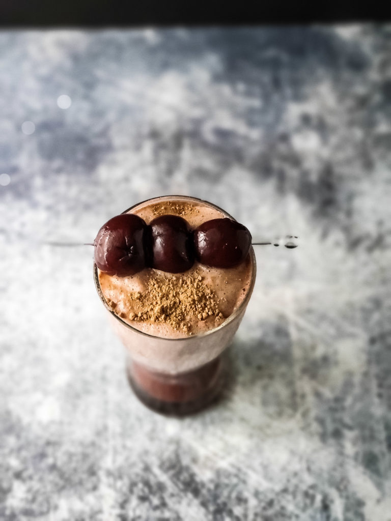 Black Forest Cherry Shake garnished with cherries and cacao powder