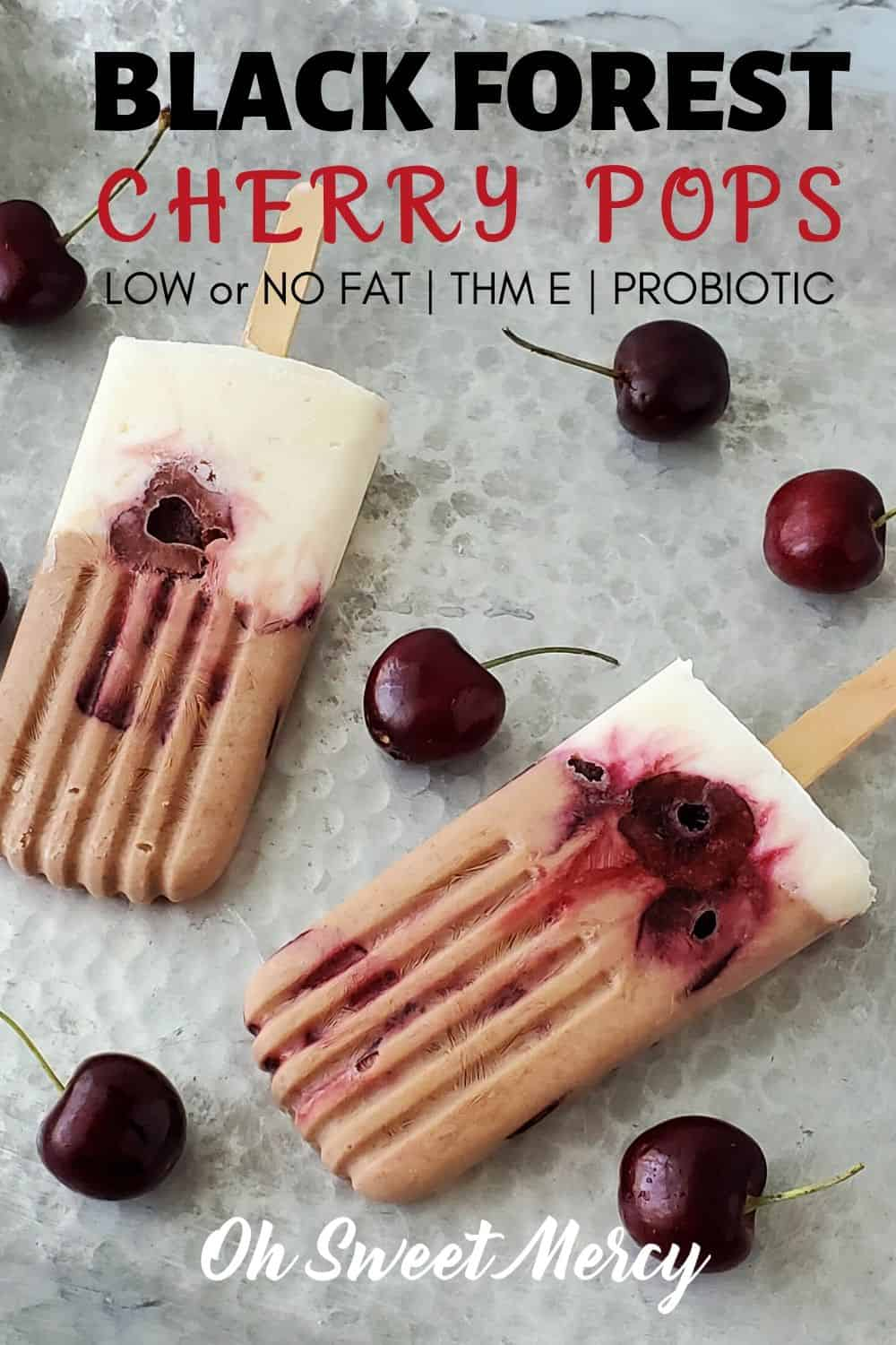 Love the flavors of Black Forest Cherry desserts but don't want all the fat and calories? My layered, low (or no) fat Black Forest Cherry pops layer creamy, chocolate Greek yogurt, dark sweet cherries, and vanilla yogurt for a healthy and delicious THM E dessert or snack. #lowfat #thm #healthycarbs #blackforestcherry #thmsnacks #thmdesserts #cacao #probiotic #yogurtpops @ohsweetmercy