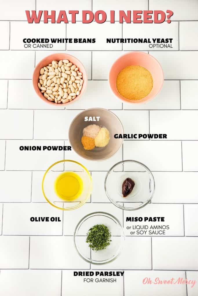 Savory White Bean Dip Ingredients: cooked or canned white beans, nutritional yeast (optional), salt, garlic powder, onion powder, olive oil, miso paste or liquid aminos or soy sauce, dried parsley for garnish