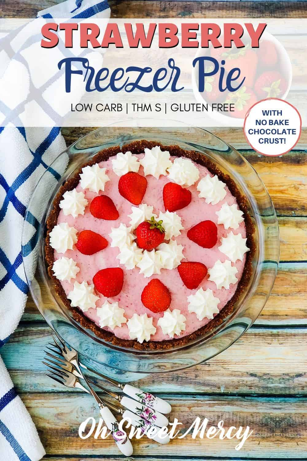 Too hot to bake? No problem! My easy Low Carb Strawberry Freezer Pie is totally no-bake! Strawberries and rich, whipped cream on a low carb chocolate crust means a delicious frozen summer treat perfect for hot days. #lowcarb #thm #thmdesserts #keto #strawberries #freezerpie @ohsweetmercy