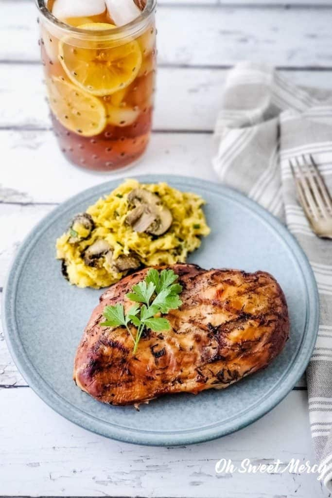 Sweet tea grilled chicken breast with buttery garlic, mushroom, and chive spaghetti squash for a low carb THM S meal.