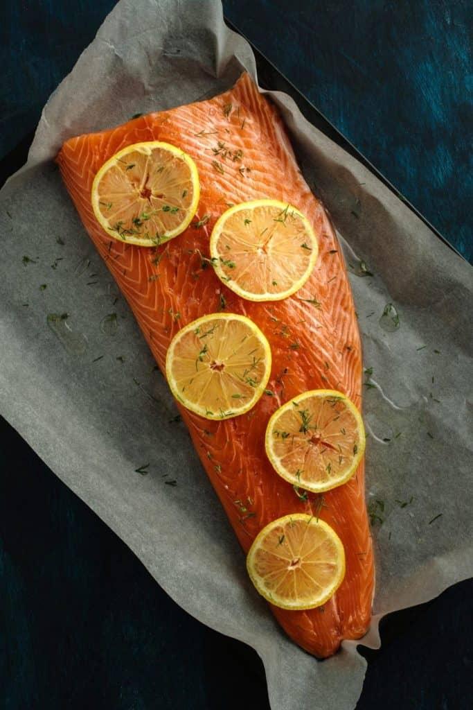 Salmon and lemon slices on baking sheet. Canva pro image