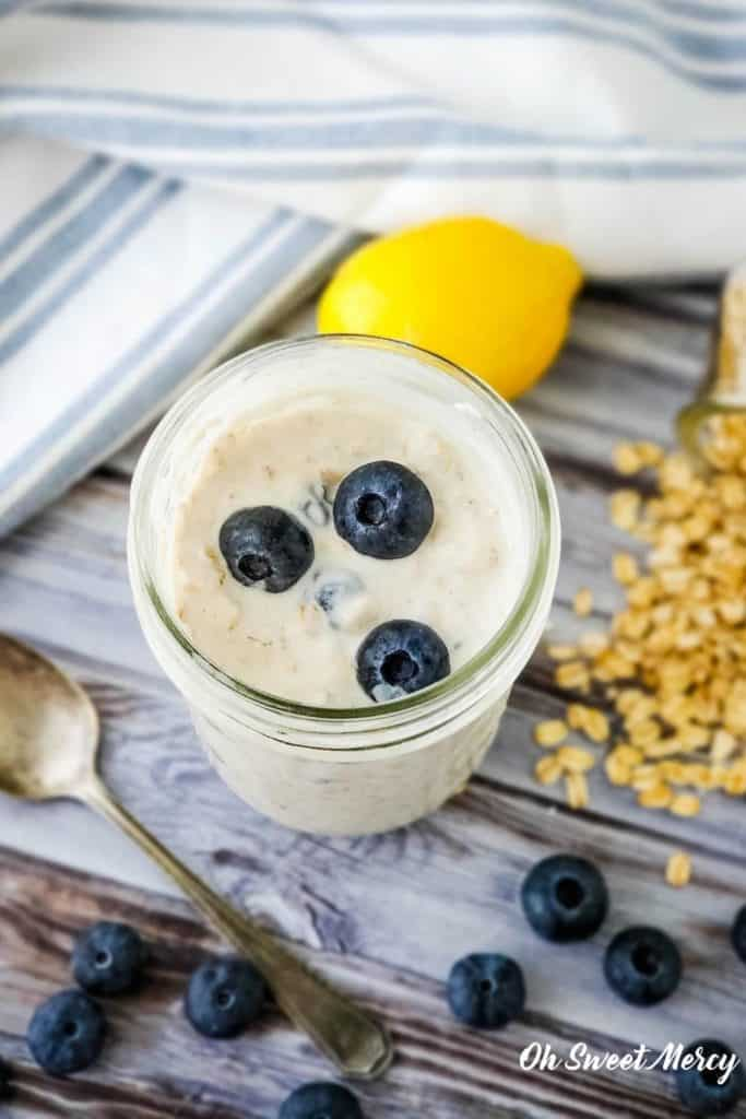 Pint jar of overnight oats with blueberries on top