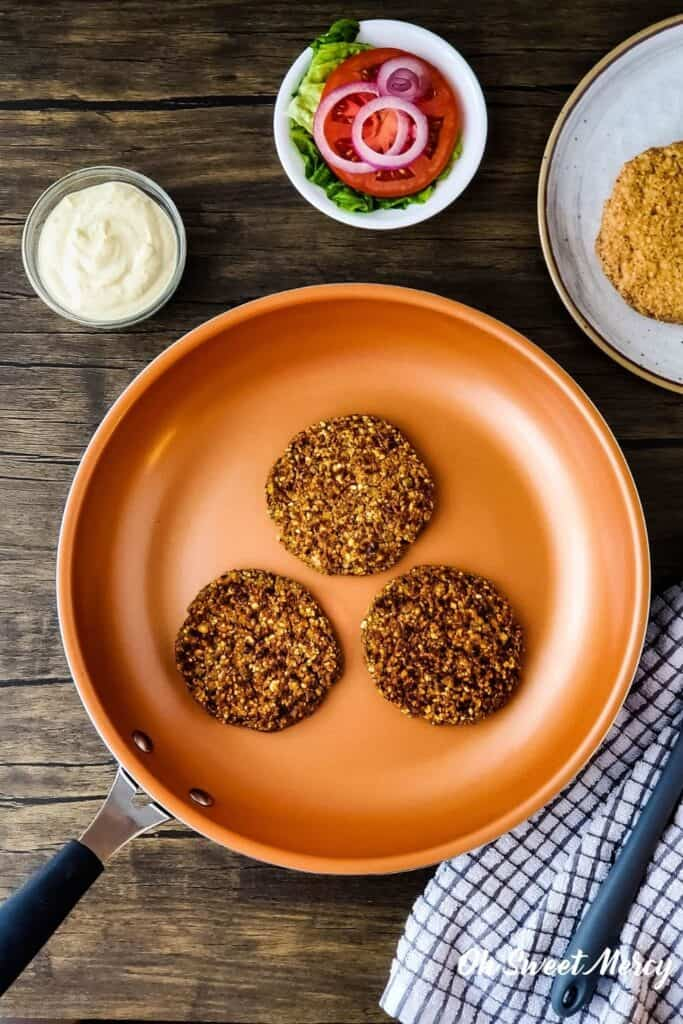 overhead shot of lentil patties in copper ceramic skillet