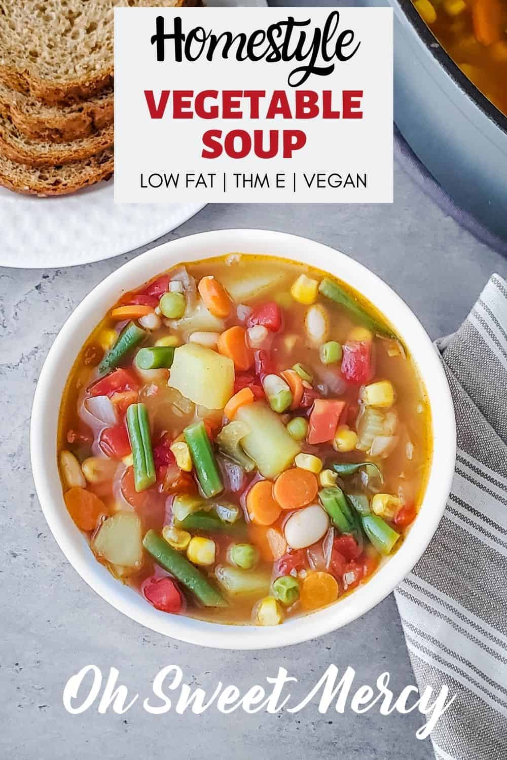 My Homestyle Vegetable Soup is packed with veggies and flavor but not fat! A healthy and delicious THM E soup, but easily tweaked to fit S or FP styles if needed. Up your plant-based meals game this year with this hearty and tasty veggie soup. #lowfat #healthycarbs #thm #vegan #vegetarian #homemade #soups