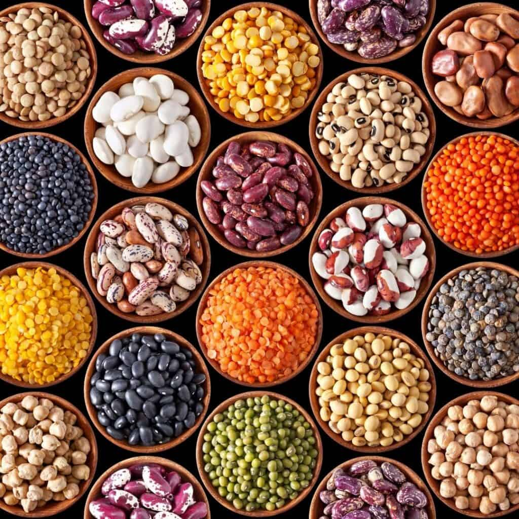 photo with many different types and colors of dry beans and legumes