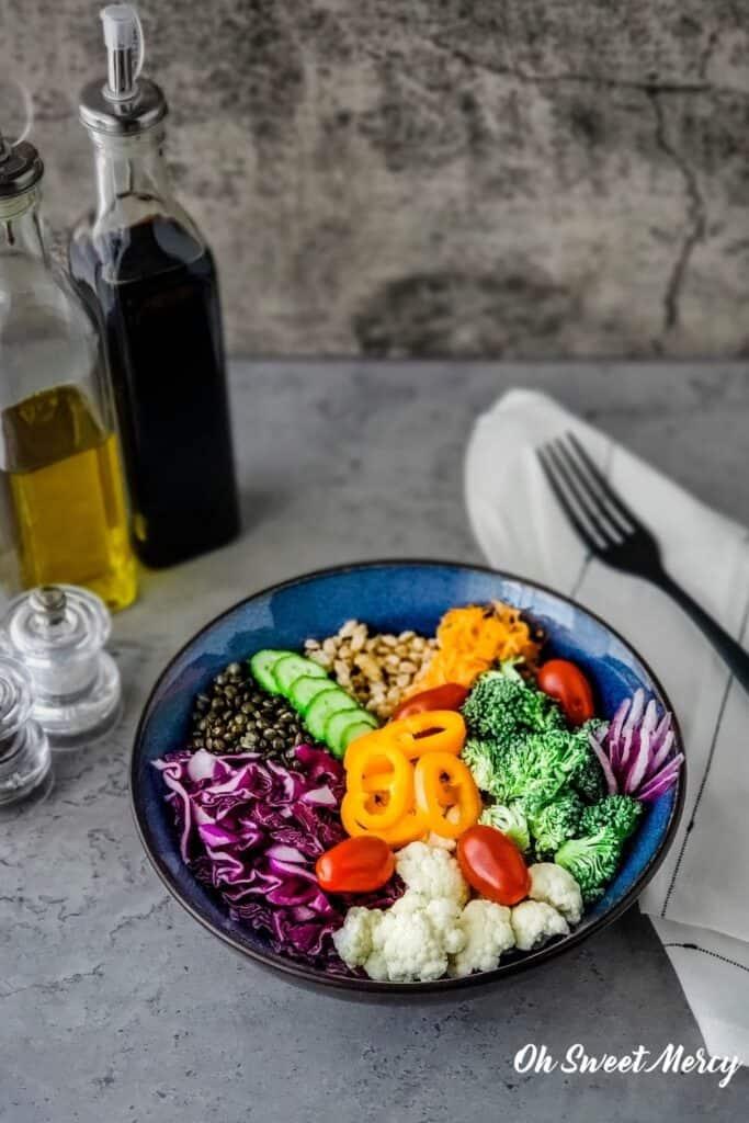 Grain bowl with oil and vinegar bottles